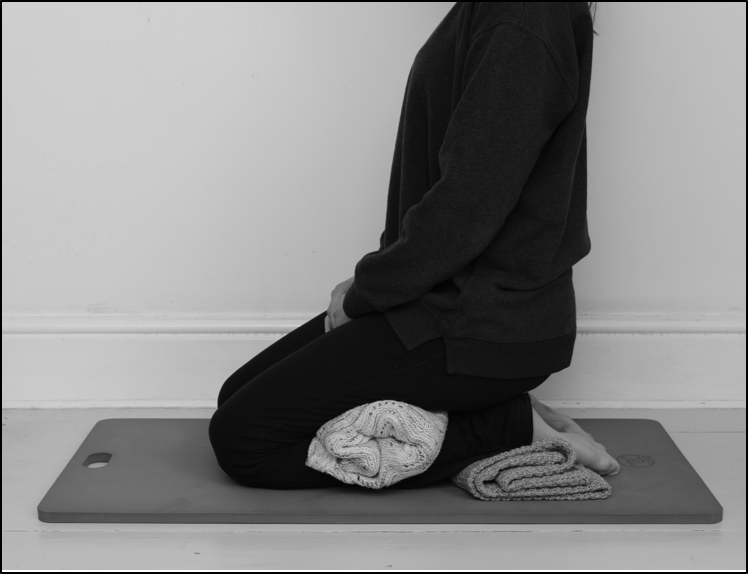 Kneeling for pelvic floor exercises