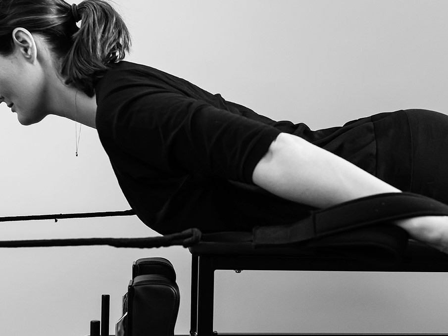 Back strengthening exercises on a reformer bed