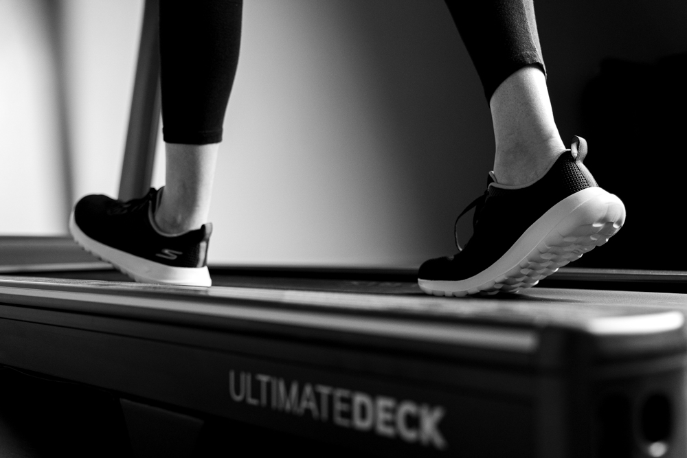 Patient exercising on a treadmill at a physiotherapy clinic